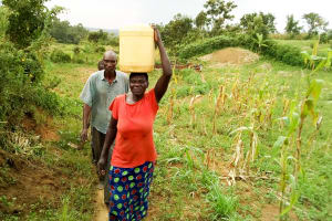 The Water Project: Musango Community, Jared Lukoko Spring -  Carrying Water Home