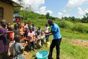 The Water Project: Ulagai Community, Rose Obare Spring -  Handwashing Training
