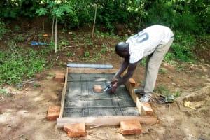 The Water Project: Mwituwa Community, Nanjira Spring -  Sanitation Platform Construction