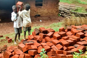 The Water Project: Mwanzo Primary School -  Shuttling Bricks