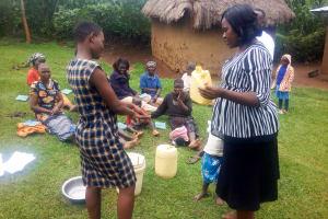 The Water Project: Mwituwa Community, Shikunyi Spring -  Building A Leaky Tin Training