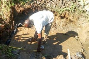The Water Project: Mwituwa Community, Nanjira Spring -  Setting The Foundation