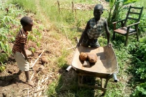 The Water Project: Musango Community, Jared Lukoko Spring -  Children Helping Deliver Materials To Artisan