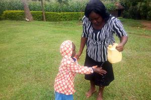 The Water Project: Mwituwa Community, Shikunyi Spring -  Leaky Tin Training