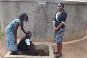 The Water Project: Friends Makuchi Secondary School -  Collecting Water From Tank
