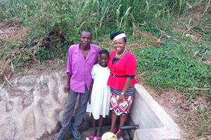 The Water Project: Mwinaya Community, Severe Spring -  Water Flowing