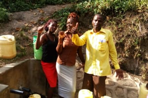 The Water Project: Shitungu Community, Hessein Spring -  Thumbs Up For Clean Water
