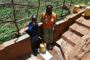 The Water Project: Mutambi Community, Kivumbi Spring -  Erick Mwalunga And Florence Chelegat