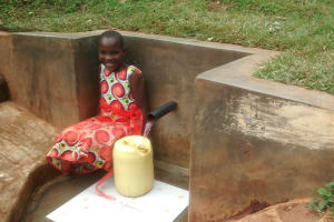 The Water Project: Wamuhila Community, Isabwa Spring -  Filling Up Jerrican With Water