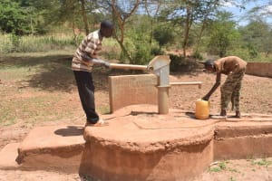 The Water Project: Mbindi Community C -  Collecting Water At Well