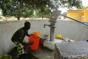 The Water Project: Tintafor, Officer's Quarters Community -  Fetching Water