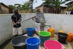 The Water Project: Tintafor, Police Barracks C-Line Community -  Collecting Water
