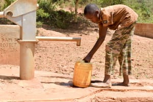 The Water Project: Mbindi Community C -  Fetching Water A Year Later