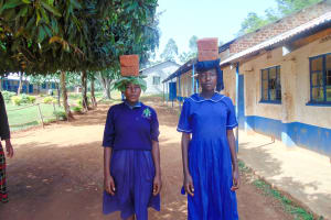The Water Project: Shina Primary School -  Diana Makokha And Selestine Mwashi From Class Seven Helping Carry Bricks To Artisans