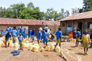 The Water Project: Emukangu Primary School, Shibuli -  Students Fetching Water For Construction