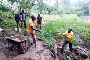 The Water Project: Irumbi Community, Okang'a Spring -  Handing Bricks Down To The Artisan