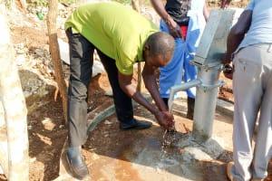 The Water Project: Kyamudikya Community -  Water Flowing