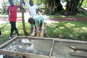 The Water Project: Irumbi Community, Okang'a Spring -  Sanitation Platform Construction