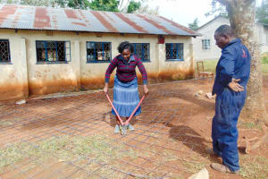 The Water Project: Shina Primary School -  Field Officer Karen Cutting Wire For The Tank