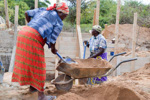The Water Project: Ilandi Community -  Filling Out The Dam With Mortar