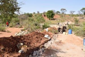 The Water Project: Ilandi Community -  Sand Dam Construction