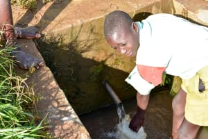 The Water Project: Eshikufu Primary School -  Fetching Water