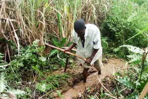 The Water Project: Luvambo Community, Tindi Spring -  Digging Drainage And Excavating