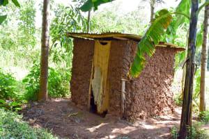 The Water Project: Mungakha Community, Nyanje Spring -  Mud Latrine