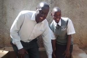 The Water Project: Matsigulu Friends Secondary School -  Edwin Odali With Achieng Violet At The Water Point