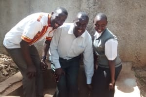 The Water Project: Matsigulu Friends Secondary School -  Eric Wagaka Poses With Teacher And Student At The Tank