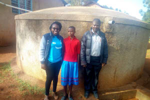 The Water Project: ADC Chanda Primary School -  Christine Luvandwa Poses With Vivian And Mr Millton At The Tank