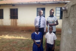 The Water Project: Ebusiloli Primary School -  Posing By Rainwater Tank