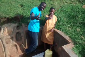 The Water Project: Mahanga Community -  Pauline Esendi Gives Thumbs Up For Clean Water