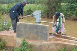 The Water Project: Ngaa Community A -  Pumping Water