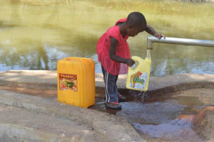 The Water Project: Ilinge Community A -  Filling Container With Water