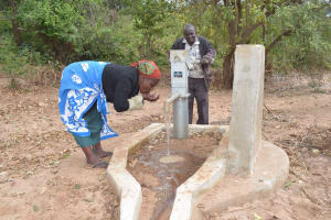 The Water Project: Nzung'u Community B -  Pumping Water