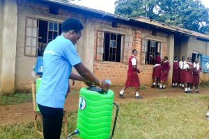 The Water Project: Shikhondi Girls Secondary School -  Trainer Setting Up Handwashing Station