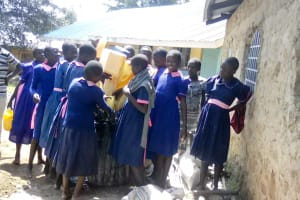 The Water Project: Makuchi Primary School -  Delivering Water To Mix Cement
