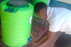 The Water Project: Imusutsu High School -  Sharon Iminza Washing Her Hands