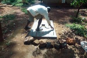 The Water Project: Shirakala Community, Ambani Spring -  Finishing Touches On Sanitation Platform