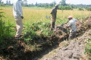 The Water Project: Matsakha Community, Siseche Spring -  Digging Drainage