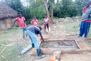 The Water Project: Ematetie Community, Weku Spring -  Sanitation Platform Construction