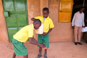 The Water Project: Jidereri Primary School -  Making A Leaky Tin