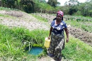 The Water Project: Luyeshe Community, Matolo Spring -  Bilha Matolo Carrying Water