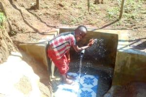 The Water Project: Musutsu Community, Mwashi Spring -  Flowing Water