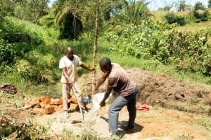 The Water Project: Luvambo Community, Timona Spring -  Mixing Concrete
