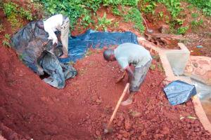 The Water Project: Shirakala Community, Ambani Spring -  Backfilling