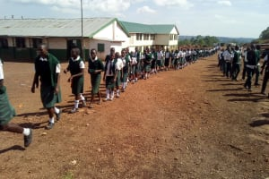 The Water Project: Kwirenyi Secondary School -  Students Lined Up For Lunch At School