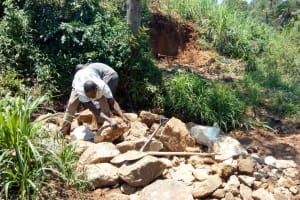The Water Project: Luvambo Community, Timona Spring -  Backfilling