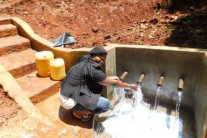 The Water Project: Shirakala Community, Ambani Spring -  Flowing Water